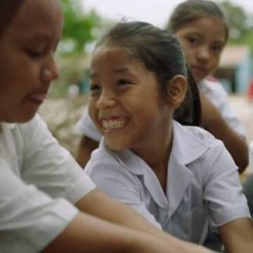 Peruvian children washing hands before taking a J&J VERMOX CHEWABLE tablet to treat intestinal worms as part of a national mass drug administration campaign.